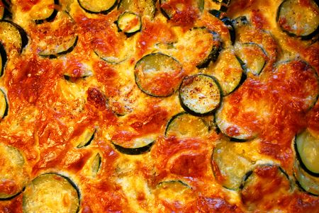 closeup of delicious zucchini casserole gratinated with cheese photo