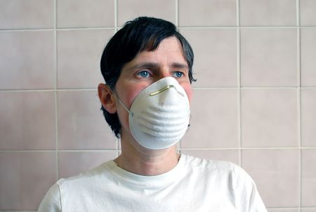 doctor or nurse with surgical mask as protection against infectious deseases photo