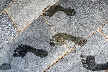 wet footprints on stone floor Stock Photo - 5061738