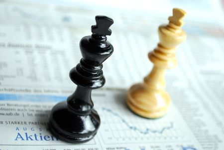 shareholder: macro of chessmen standing on latest stock exchanges