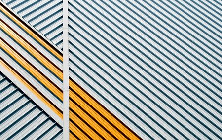 muster: yellow and white striped facade with a geometrical pattern Stock Photo