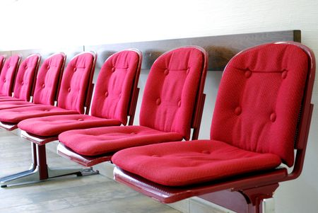 red seats in a row in a waiting room photo