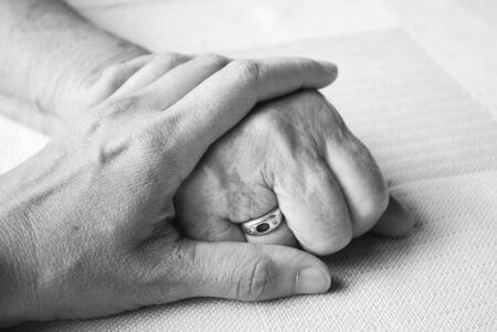 hand of a doctor and senior and senior patient Stock Photo - 5740565