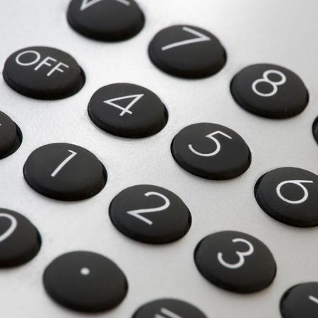 businees: close-up of a silver calculator with black push buttons