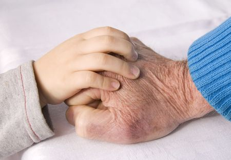 hand of a child and grandfather Stock Photo