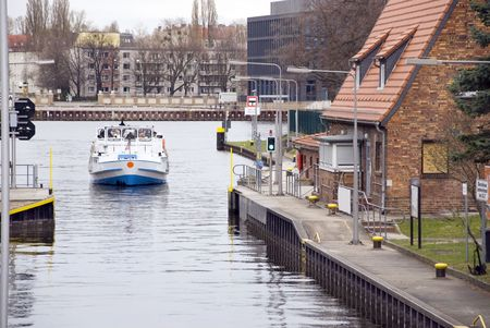 treptow: water gate with boat in berlin treptow