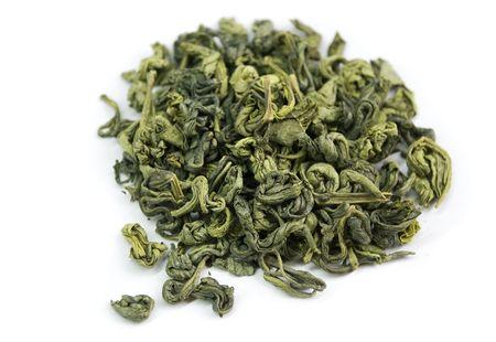 dried green tea leaves on white photo