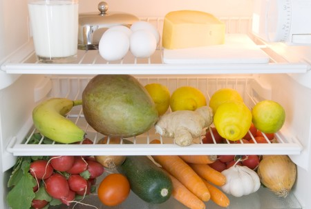 dairy products, fruits and vegetables in a refrigerator photo