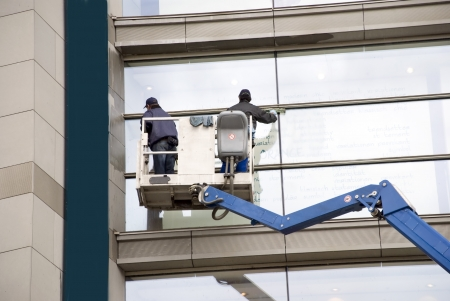 cleaning window: window washers on a hydraulic ramp Stock Photo