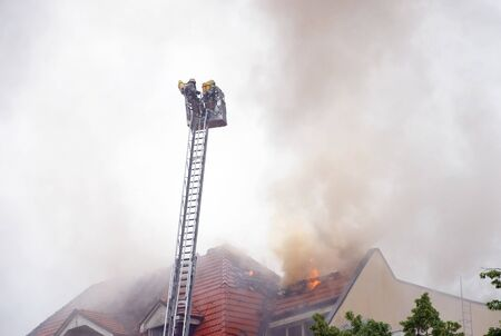 german fire fighters with aerial ladder Stock Photo - 7144958