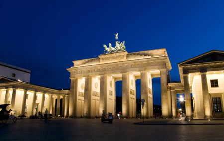 brandenburg gate: berlin brandenburg gate at night with blue sky