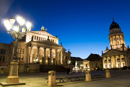 berlin, gendarmenmarkt at sunset with deep blue sky