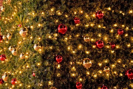 detail of christmas tree with ornaments photo