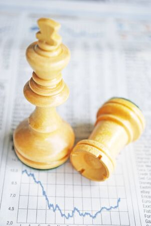 takeover: two chessmen, king and tower and stock charts