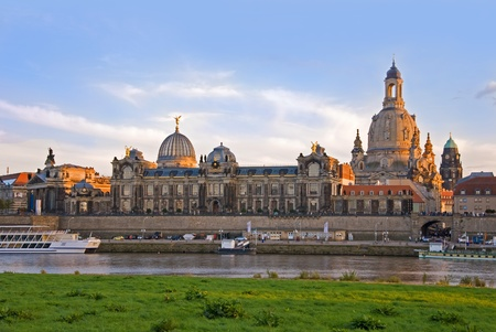dresden: dresden skyline with river elbe and boats at sunset