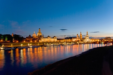 dresden: dresden skyline at night with elbe river and ships Stock Photo
