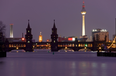 oberbaumbruecke berlin at night with river spree and tv tower