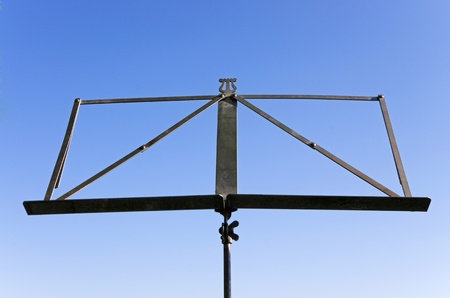 music stand in front of deep blue sky at a concert photo