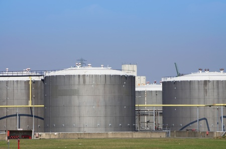 oil tanks in a refinery with blue sky