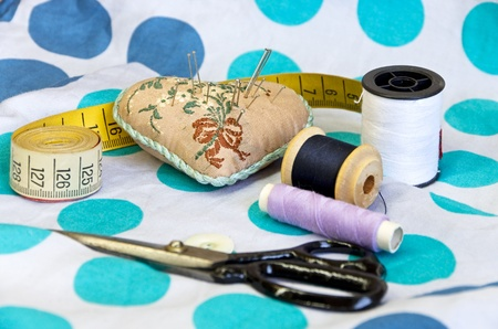 sewing kit: sewing kit with cloth scissors measure tape and needles