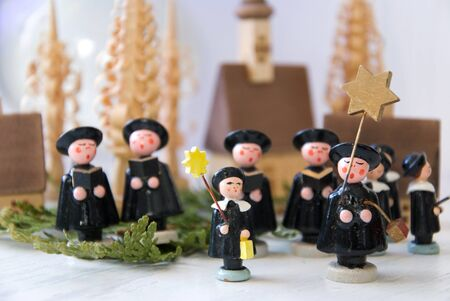 erzgebirge: carolers made of wood a traditional handicraft product of germany