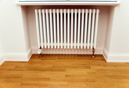 heat home: home improvement new radiator and new parquet Stock Photo