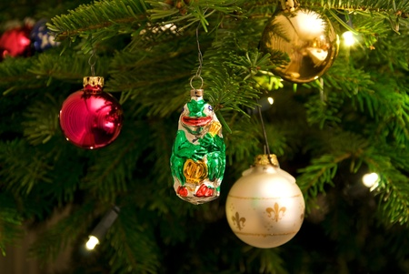christmas tree with ornaments and electrical candles photo