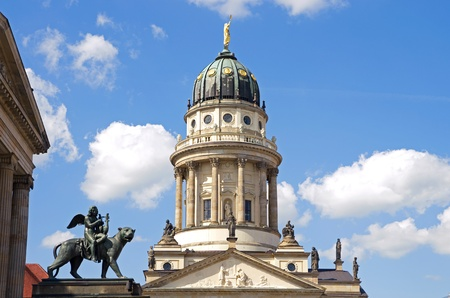 lion sculpture and french dome at gendarmenmarkt berlin germany Stock Photo - 11747126