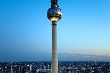 television tower and skylin of berlin at sunset