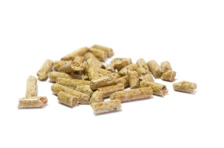 pellets: macro of wood pellets isolated on white