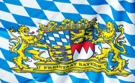 blue and white bavarian flag and crest in sunlight
