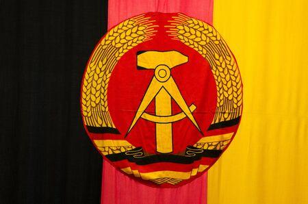 ddr: close-up of the former ddr gdr german flag in black red gold