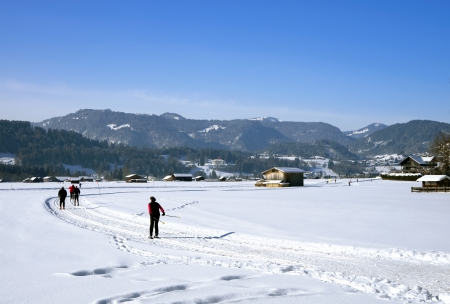 people on cross country ski-run in village  Oberstdorf , mountain  Nebelhorn ,  Oberallg�u ,  Allg�u , bavaria, germany photo