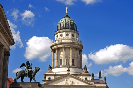 lion sculpture and french dome at gendarmenmarkt berlin germany Stock Photo - 20893248