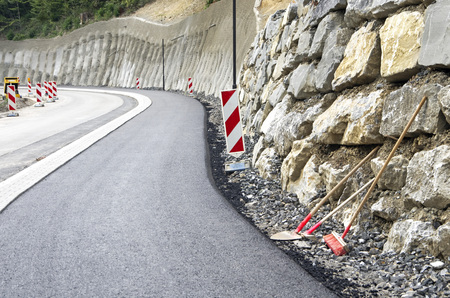 raod: road construction site with work tools in germany Stock Photo
