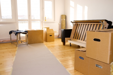 moving boxes in a flat with parquet floor Stock Photo