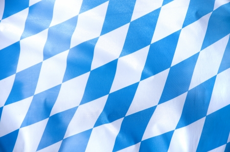 bayern: blue and white bavarian flag waving in the wind Stock Photo