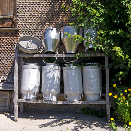 allgau: many milk cans on old farm in bavaria, germany Stock Photo