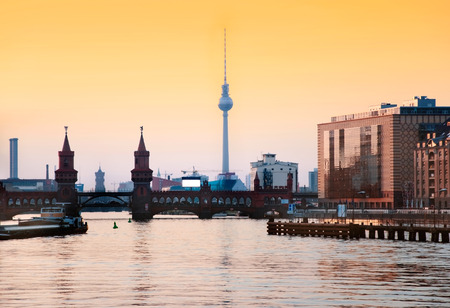berlin oberbaum bridge with tv tower at sunset