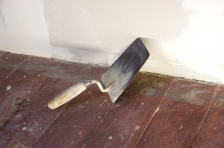 walling: brick trowel on a construction site as a working scene