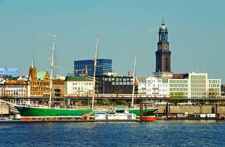sailer: famous hamburg harbor with michel church and sailing ship rickmer rickmers