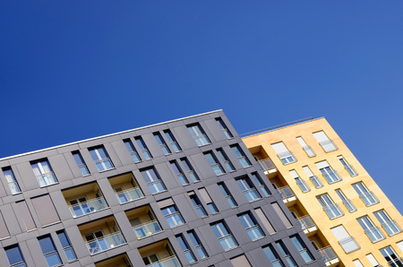 rental property: modern living in Berlin - new facades and blue sky