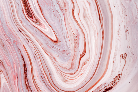 Swirls of marble or the ripples of agate. Liquid marble texture with pink and brown colors. Abstract painting background for wallpapers, posters, cards, invitations, websites. Fluid art.