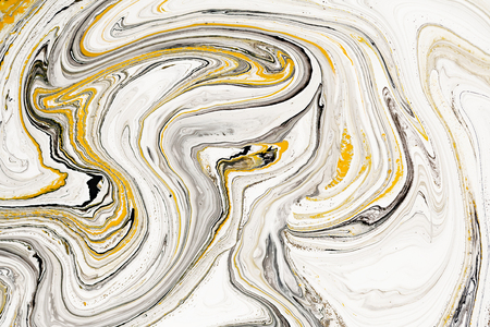 Mixture of acrylic paints. Modern artwork. Yellow and black mixed acrylic paints. Liquid marble texture. Applicable for design packaging, labels, business cards, and interactive web backgrounds.