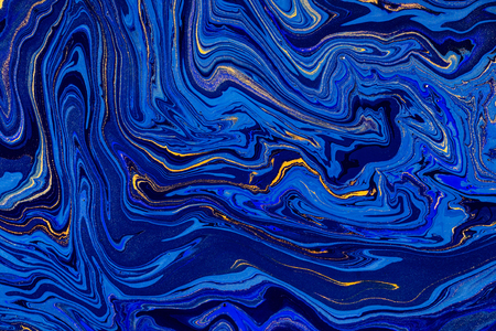 Hand painted background with mixed liquid blue and golden paints. Abstract fluid acrylic painting. Modern art. Marbled blue abstract background. Liquid marble pattern Stock Photo