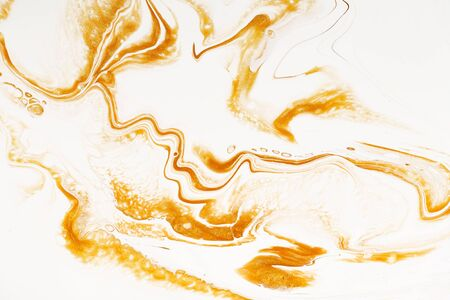 Golden dynamic and fluid raster texture. Abstract acrylic paints mixt color background. Dyeing, liquid flow surface modern design. Orange and white contrast pigments, watercolor wallpaper
