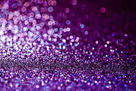 Purple glitter raster festive background. Abstract violet blurred circles. Bokeh lights with bright shiny effect illustration. Overlapping glowing and twinkling spots decorative backdrop design Фото со стока