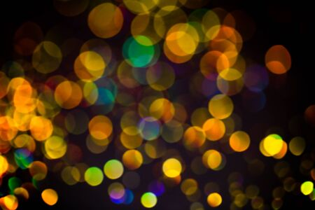 Multicolor glitter raster background. Abstract shimmering red circles on deep purple backdrop. Vibrant bokeh lights effect festive illustration. Overlapping glowing and twinkling spots