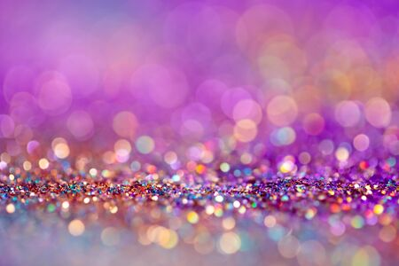 Festive twinkle lights background, abstract blurred backdrop with circles,modern design wallpaper with sparkling glimmers. Pink, purple and golden backdrop glittering sparks with blur effect Stock Photo