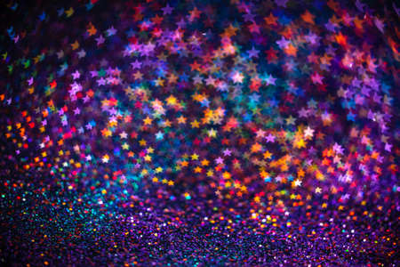 Decoration twinkle glitters background, abstract shiny backdrop with stars, modern design overlay with sparkling glimmers. Purple, blue and red backdrop glittering sparks with blur effect